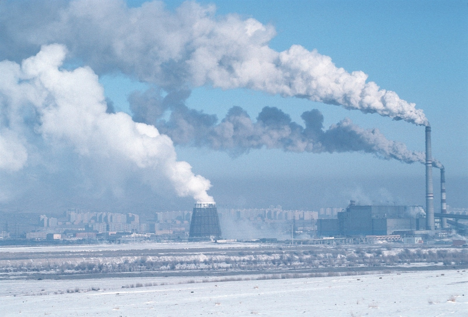 Factory chimneys spewing smoke and pollution into the atmosphere on the outskirts of Ulan Bator.